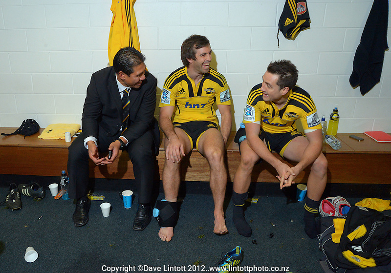 Assistant coach Alama Ieremia relaxes with Conrad Smith and Tim Bateman in the changing rooms after the Super 15 rugby match between the Hurricanes and Chiefs at Westpac Stadium, Wellington, New Zealand on Friday, 13 July 2012. Photo: Dave Lintott / lintottphoto.co.nz. HURRICANES USE ONLY.