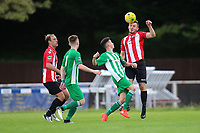 Kenzer Lee of Hornchurch heads clear during AFC Hornchurch vs Soham Town Rangers, Bostik League Division 1 North Football at Hornchurch Stadium on 12th August 2017