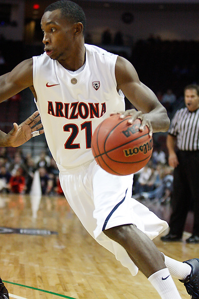 Nov. 26, 2010. Las Vegas, NV: The Arizona Wildcats' Kyle Fogg drives to the hoop in the Las Vegas Invitational at the Orleans Arena.