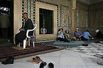 Tunisian people in the courtyard of the Mosque of the Barber, Kairouan, Tunisia.