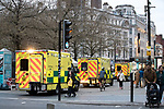 © Joel Goodman - 07973 332324 . 06/04/2017 . Manchester , UK . Three ambulances visible (and a further two rapid response vehicles and a bicycle paramedic) lined up in Piccadilly Gardens , responding to numerous instances of people believed to have consumed spice . An epidemic of abuse of the drug spice by some of Manchester's homeless population , in plain sight , is causing users to experience psychosis and a zombie-like state and is daily being witnessed in the Piccadilly Gardens area of Manchester , drawing large resource from paramedic services in the city centre . Photo credit : Joel Goodman