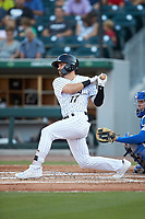 Danny Mendick (17) of the Charlotte Knights follows through on his swing against the Buffalo Bisons at BB&T BallPark on July 24, 2019 in Charlotte, North Carolina. The Bisons defeated the Knights 8-4. (Brian Westerholt/Four Seam Images)