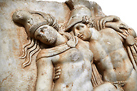 Detail of a  Roman Sebasteion relief sculpture of Achilles and a dying Amazon, Aphrodisias Museum, Aphrodisias, Turkey.       Against a white background.<br /> <br /> Achilles supports the dying Amazon queen Penthesilea whom he has mortally wounded. Her double headed axe slips from her hands. The queen had come to fight against the Greeks in the Trojan war and Achilles fell in love with her.