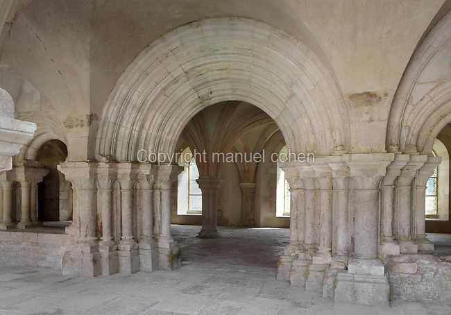 Cloister and Chapter House, Fontenay Abbey, Marmagne, Cote d'Or, France. This Cistercian abbey was founded by Saint Bernard of Clairvaux in 1119, built in the Romanesque style. The abbey itself housed 300 monks from 1200, but was sacked during the French Revolution. The 36m cloister dates from the 12th century and one arch leads directly to the Chapter House, a rib-vaulted open chamber where the monks gathered daily to read a chapter from St Benedict's Rule. Picture by Manuel Cohen