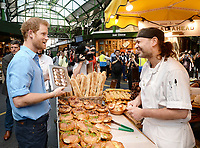 15 June 2017 - Prince Harry is given a book by the Bread Ahead stand during a visit to Borough Market in London which has opened yesterday for the first time since the London Bridge terrorist attack. Photo Credit: ALPR/AdMedia
