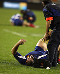 Two French teammates lie injured during the bruising encounter in the first international rugby test at Eden Park, Auckland, New Zealand, Saturday, June 02, 2007. The All Blacks beat France 42-11.