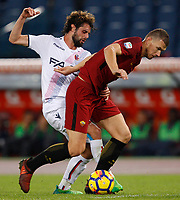 Roma's Edin Dzeko, right, is challenged by Bologna's  Andrea Poli during the Serie A football match between Roma and Bologna at Rome's Olympic stadium, October 28, 2017.<br /> UPDATE IMAGES PRESS/Riccardo De Luca