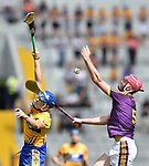 John Conlon of Clare in action against Paudie Foley of Wexford during their All-Ireland quarter final at Pairc Ui Chaoimh. Photograph by John Kelly.