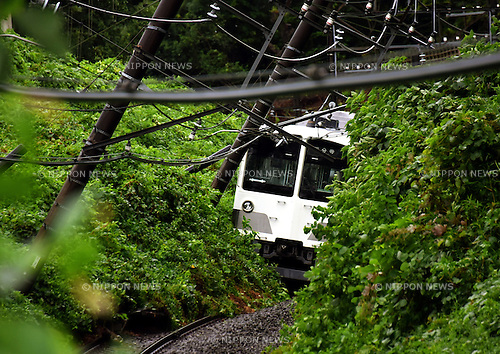 August 22, 2016, Tokyo, Japan - A rural commuter train remains derailed after jumping the track near Higashi-Murayama in the western suburbs of Tokyo on Monday, August 22, 2016. Approaching Typhoon Mindulle drenched more than four inches of rain an hour in part of Tokyo and the surrounding region.  (Photo by Natsuki Sakai/AFLO) AYF -mis-