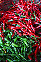 Red and green chili peppers on sale in a market in central Jakarta.<br /> <br /> To license this image, please contact the National Geographic Creative Collection:<br /> <br /> Image ID:  1588051<br />  <br /> Email: natgeocreative@ngs.org<br /> <br /> Telephone: 202 857 7537 / Toll Free 800 434 2244<br /> <br /> National Geographic Creative<br /> 1145 17th St NW, Washington DC 20036