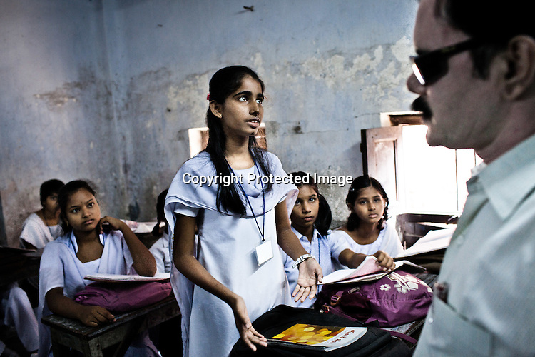 Schoolgirls from the Devanga community attend class in Mahesh Sri Potti Sri Ramulu Andhra High Schhol in Mahesh, Hooghly in West Bengal, India.  Photo: Sanjit Das/Panos for The Wall Street Journal. Slug: ICASTE