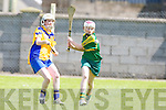 Kerry's Melissa Dineen gets her point against Roscommon's Aoife McDermott in the All Ireland U16' s camogie championship at Kilmoyley on Sunday.