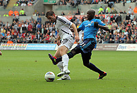 Pictured L-R: Angel Rangel of Swansea challenged by Yousouff Mulumbu of West Bromwich Albion. Saturday 17 September 2011<br /> Re: Premiership football Swansea City FC v West Bromwich Albion at the Liberty Stadium, south Wales.