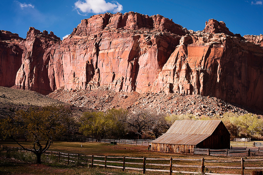 Red rock rises around the town of Fruita in Capital Reef National Park.
