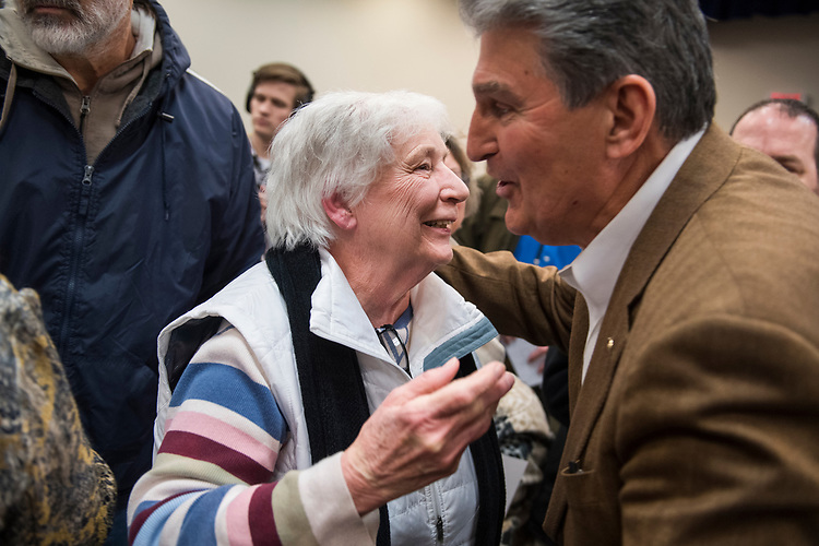UNITED STATES - MARCH 16: Sen. Joe Manchin, D-W.Va., greets a guest after a town hall meeting at the WVU Robert C. Byrd Health Sciences Center in Martinsburg, W.Va., March 16, 2017. Much of the discussion was regarding the American Health Care Act, the Republican's plan to repeal and replace the ACA. (Photo By Tom Williams/CQ Roll Call)