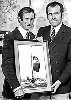With a painting of their yacht, Whiskee Too, are Bill Whicker, left, and Jim McKee. It was presented to them by the N Ireland Sports Council in recognition of their winning a world sailing championship event in New Jersey, USA, in August 1975. 197510140697b<br />