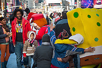 "Costumed characters swarm Times Square in New York on Friday, December 28, 2012. The ""actors"" pose for photographs with tourists asking for tips as renumeration. Recently a number of them have been embroiled in controversy for groping women and anti-semitic ranting. Otherwise they just aggressively come up to people soliciting photos. (© Richard B. Levine)"