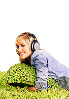 Teenage girl listening to music through headphones