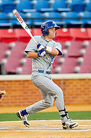 Patrick Koontz #16 of the UNC-Asheville Bulldogs follows through on his swing against the Wake Forest Demon Deacons at Wake Forest Baseball Park on February 28, 2012 in Winston-Salem, North Carolina.  The Demon Deacons defeated the Bulldogs 9-8.  (Brian Westerholt/Four Seam Images)