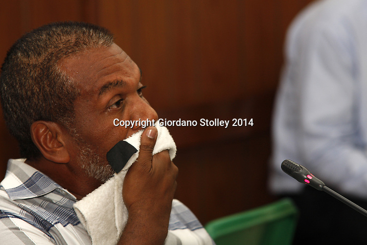 DURBAN - 13 February 2014 - Safety consultant Ismaiel van Zyl  wipes the sweat from his face as he is grilled about an apparent litany of safety shortcomings to a Department of Labour commission of inquiry investigating the November 19 collapse of the Tongaat mall, which claimed two lives and injured 19, there were no health and safety audits. Picture: Allied Picture Press/APP