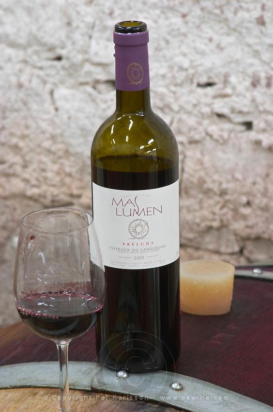 Cuvee Prelude 2003. Domaine Mas Lumen in Gabian. Pezenas region. Languedoc. Barrel cellar. France. Europe. Bottle. Wine glass.
