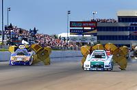 May 31, 2009; Topeka, KS, USA: NHRA funny car driver Ron Capps (left) slows down after defeating Ashley Force Hood in the final round of the Summer Nationals at Heartland Park Topeka. Mandatory Credit: Mark J. Rebilas-