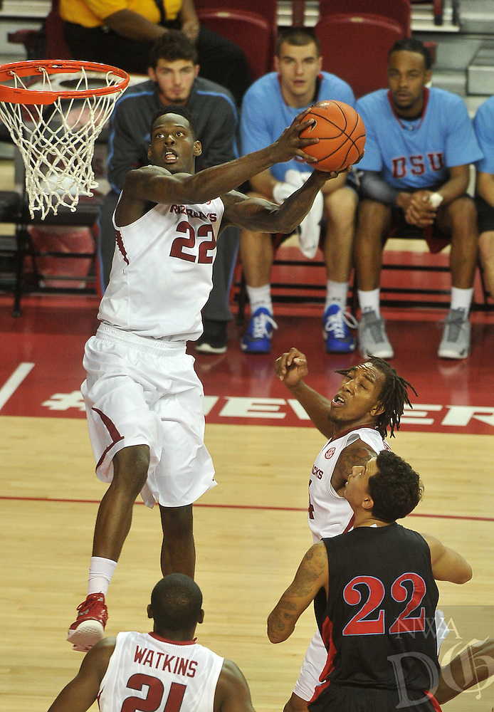 NWA Media/Michael Woods --11/21/2014-- w @NWAMICHAELW...University of Arkansas forward Jacorey Williams goes up for the dunk after getting the pass from teammate Michael Qualls during the first half of Friday nights game  against Delaware State at Bud Walton Arena in Fayetteville.