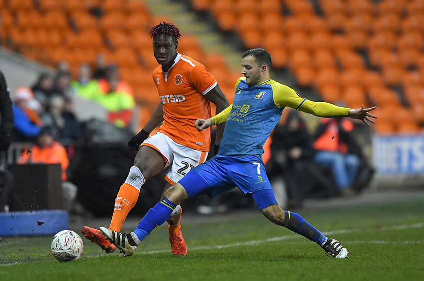 Blackpool's Armand Gnanduillet battles with Solihull Moors' Jamey Osborne<br /> <br /> Photographer Dave Howarth/CameraSport<br /> <br /> The Emirates FA Cup Second Round Replay - Blackpool v Solihull Moors - Tuesday 18th December 2018 - Bloomfield Road - Blackpool<br />  <br /> World Copyright © 2018 CameraSport. All rights reserved. 43 Linden Ave. Countesthorpe. Leicester. England. LE8 5PG - Tel: +44 (0) 116 277 4147 - admin@camerasport.com - www.camerasport.com