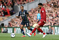 Liverpool's Joe Gomez threads a pass despite the attentions of Manchester City's Raheem Sterling<br /> <br /> Photographer Rich Linley/CameraSport<br /> <br /> The Premier League - Liverpool v Manchester City - Sunday 7th October 2018 - Anfield - Liverpool<br /> <br /> World Copyright &copy; 2018 CameraSport. All rights reserved. 43 Linden Ave. Countesthorpe. Leicester. England. LE8 5PG - Tel: +44 (0) 116 277 4147 - admin@camerasport.com - www.camerasport.com