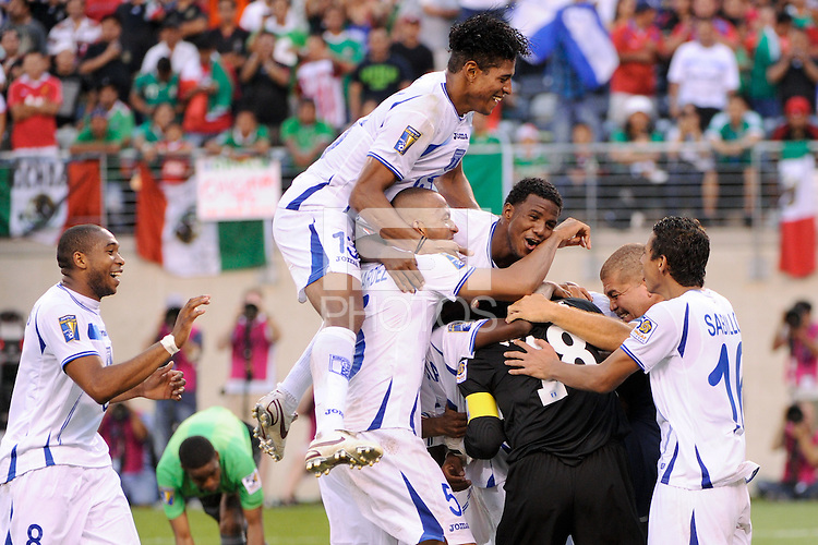 Honduras players celebrate winning on penalty kicks. Honduras defeated Costa Rica on penalty kicks after playing to a 1-1 tie during a quarterfinal match of the 2011 CONCACAF Gold Cup at the New Meadowlands Stadium in East Rutherford, NJ, on June 18, 2011.