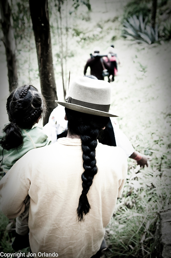 Members of The Pakarinka Sisari Ancestral Wisdom Center near Otavalo, Ecuador, head to the fields to harvest fava beans.