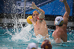 BERKELEY, CA - DECEMBER 04:  Blake Edwards (12) of the University of Southern California is defended by Chandler Jarrels of the University of California at Berkeley during the Division I Men's Water Polo Championship held at the Spieker Aquatics Complex on December 04, 2016 in Berkeley, California.  Cal defeated USC 11-8 for the national title. (Photo by Justin Tafoya/NCAA Photos via Getty Images)
