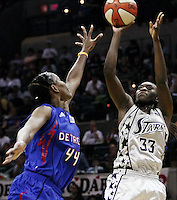 San Antonio's Sophia Young (33) takes a shot as Detroit's Taj McWilliams-Franklin (44) attempts to block, during Game 2 of the WNBA Finals between the Detroit Shock and the San Antonio Silver Stars, Oct. 3, 2008, at the AT&T Center in San Antonio. Detroit won 69 - 61 to go up 2 - 0 in the best-of-five series. (Darren Abate/pressphotointl.com)