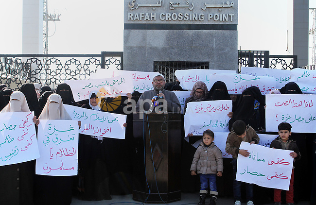 Palestinian women take part during a rally at Rafah border crossing calling on Egyptian authorities to open the crossing, in Rafah in the southern Gaza Strip December 22, 2015. Egypt has kept its Rafah crossing largely shut since Cairo's Islamist president was toppled by the army in 2013. Since then, it opened the crossing partially and on a few occasions to allow thousands of Palestinians to travel in and out of the Gaza Strip, border officials said. Photo by Abed Rahim Khatib