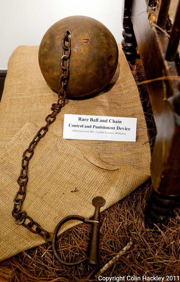 HISTORY'S WEIGHT: A slave ball and chain is part of the Slavery in the Old South collection of The Black Archives in Tallahassee..COLIN HACKLEY PHOTO