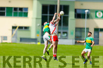 A tussle for possession between Rob Ó Sé from An Ghaeltacht and Michael Wrenn of John Mitchels in the Intermediate Football Championship.