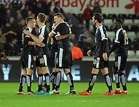 Leicester City players embrace each other after the end of the game during the Barclays Premier League match between Swansea City and Leicester City at the Liberty Stadium, Swansea on December 05 2015