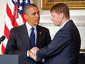 United States President Barack Obama, right, shakes hands with Richard Cordray, Director of the Consumer Financial Protection Bureau, right, after delivering a statement in the State Dining Room of the White House in Washington, D.C. on Wednesday, July 17, 2013. <br /> Credit: Ron Sachs / Pool via CNP