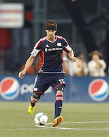 New England Revolution defender Stephen McCarthy (15) passes the ball.  In a Major League Soccer (MLS) match, Houston Dynamo (orange) defeated the New England Revolution (blue), 2-1, at Gillette Stadium on July 13, 2013.