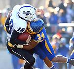 BROOKINGS, SD - NOVEMBER 9:  Doug Peete #34 from South Dakota State University brings down Robert Tonyan #18 from Indiana State University Saturday at Coughlin Alumni Stadium. (Photo by Dave Eggen/Inertia)