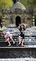 04/05/15<br /> <br /> Eight-year-old pals, Rebecca Andren and Lillianna Rocchelli cool-off in the Cascade as people flock to enjoy the Bank Holiday Monday weather in the gardens of Chatsworth House, in the Derbyshire Peak District. <br /> <br /> All Rights Reserved - F Stop Press.  www.fstoppress.com. Tel: +44 (0)1335 418629 +44(0)7765 242650