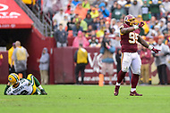 Landover, MD - September 23, 2018: Washington Redskins defensive tackle Da'Ron Payne (95) celebrates sack of Green Bay Packers quarterback Aaron Rodgers (12) during game between the Green Bay Packers and the Washington Redskins at FedEx Field in Landover, MD. The Redskins get the win 31-17 over the visiting Packers. (Photo by Phillip Peters/Media Images International)