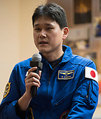 Expedition 54 flight engineer Norishige Kanai of Japan Aerospace Exploration Agency (JAXA) answers a question during a press conference, Saturday, December 16, 2017 at the Cosmonaut Hotel in Baikonur, Kazakhstan. Expedition 54 Soyuz Commander Anton Shkaplerov of Roscosmos, flight engineer Scott Tingle of NASA, and flight engineer Norishige Kanai of Japan Aerospace Exploration Agency (JAXA) are scheduled to launch to the International Space Station aboard the Soyuz spacecraft from the Baikonur Cosmodrome on December 17.<br /> Mandatory Credit: Joel Kowsky / NASA via CNP