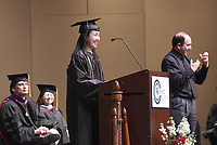NWA Democrat-Gazette/FLIP PUTTHOFF <br /> Meina Wang Cogan, an NWACC distinguished graduate, speaks Saturday May 13 2017 during the 2p.m. ceremony at the 27th annual Northwest Arkansas Community College commencement. Jason Shifflett (right) signs her remarks.