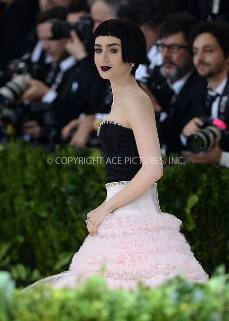 www.acepixs.com<br /> <br /> May 1 2017, New York City<br /> <br /> Lily Collins arriving at the 'Rei Kawakubo/Comme des Garcons: Art Of The In-Between' Costume Institute Gala at the Metropolitan Museum of Art on May 1, 2017 in New York City<br /> <br /> By Line: Kristin Callahan/ACE Pictures<br /> <br /> <br /> ACE Pictures Inc<br /> Tel: 6467670430<br /> Email: info@acepixs.com<br /> www.acepixs.com