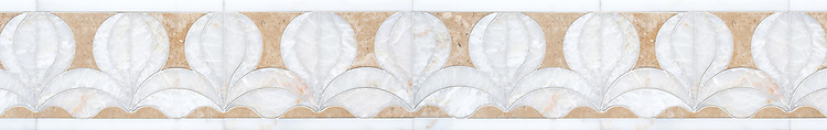 "6 1/4"" Calla border, a handmade mosaic shown in honed Lavigne and polished Cloud Nine, is part of the Miraflores collection by Paul Schatz for New Ravenna."