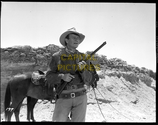 JOHN WAYNE.in Hondo (They Called Him Hondo) .**Editorial Use Only**.CAP/PLF.Supplied by Capital Pictures