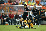 17 July 2004: Dema Kovalenko (21) steps through a tackle by Ryan Suarez (bottom) in the first half while Jaime Moreno (99) trails the play. Los Angeles Galaxy tied DC United 1-1 at RFK Stadium in Washington, DC during a regular season Major League Soccer game...