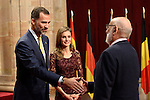 Spain's Crown Prince Felipe (L) and Princess Letizia give a medal to Belgian scientist François Englert, one of the laureates of the 2013 Prince of Asturias Award for Technical and Scientific Research, during an official audience at the Reconquista Hotel in Oviedo, Spain. October 25, 2013..(ALTERPHOTOS/Victor Blanco)