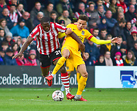 Lincoln City's John Akinde vies for possession with  Northampton Town's Shaun McWilliams<br /> <br /> Photographer Andrew Vaughan/CameraSport<br /> <br /> Emirates FA Cup First Round - Lincoln City v Northampton Town - Saturday 10th November 2018 - Sincil Bank - Lincoln<br />  <br /> World Copyright © 2018 CameraSport. All rights reserved. 43 Linden Ave. Countesthorpe. Leicester. England. LE8 5PG - Tel: +44 (0) 116 277 4147 - admin@camerasport.com - www.camerasport.com